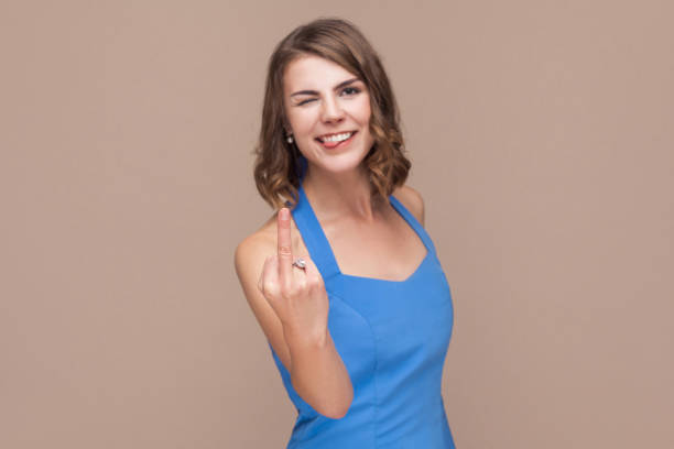 Crazy happiness woman showing fuck sign but not seriously stock photo