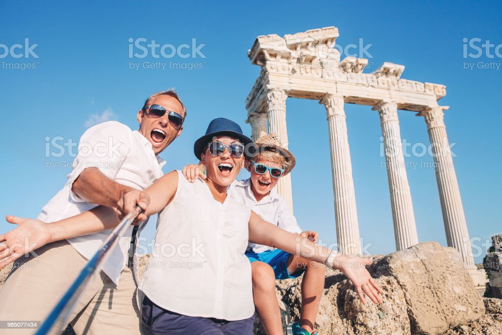 Crazy happy family selfie travel photo on the antique colonnade background. Temple of Apollo,Side,Turkey zbiór zdjęć royalty-free
