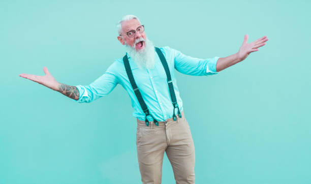 Crazy hipster man posing in front of the mcamera - Fashion tattoed guy having fun wearing trendy clothes - Joyful elderly lifestyle concept - Focus on face Crazy hipster man posing in front of the mcamera - Fashion tattoed guy having fun wearing trendy clothes - Joyful elderly lifestyle concept - Focus on face baby boomers stock pictures, royalty-free photos & images