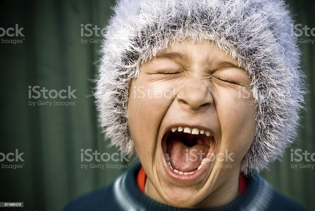Crazy kid screaming loudly royalty-free stock photo