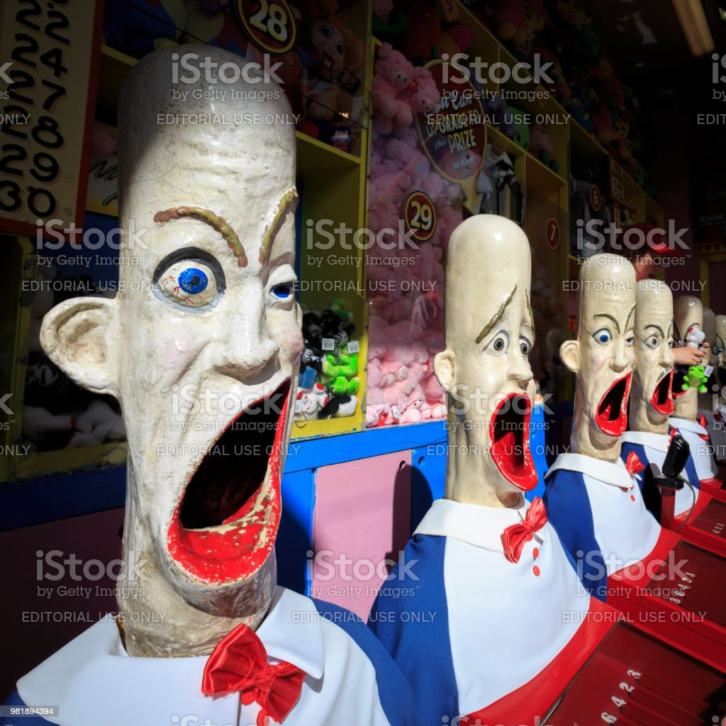 Crazy looking heads in amusement park game booth, Luna Park, Sydney, Australia stock photo