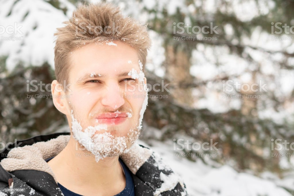 crazy mad bearded man frost face covered by snow, emotional face...