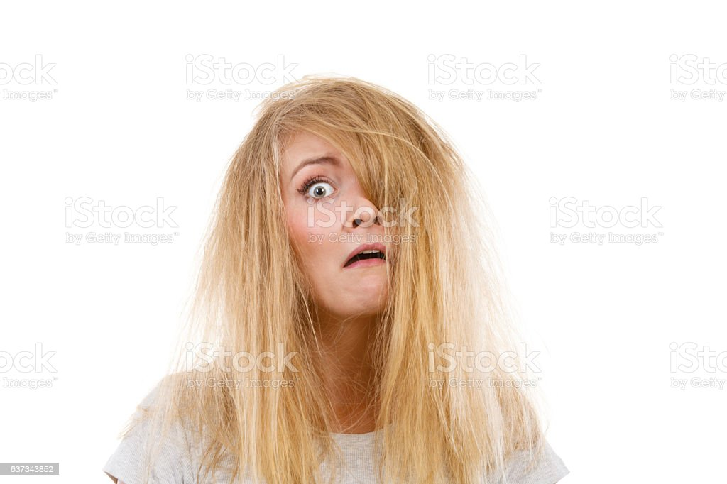 Crazy, mad blonde woman with messy hair stock photo