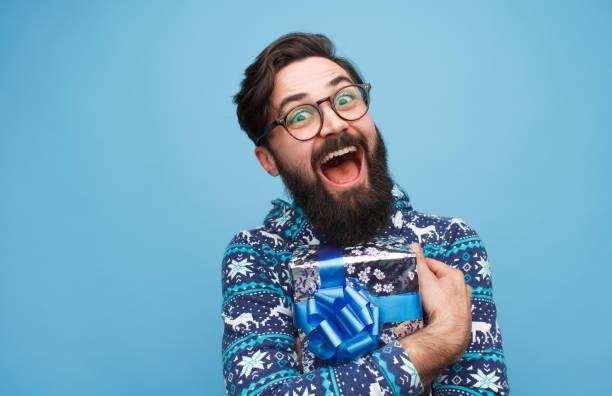 crazy man happy with present - regalo natale foto e immagini stock