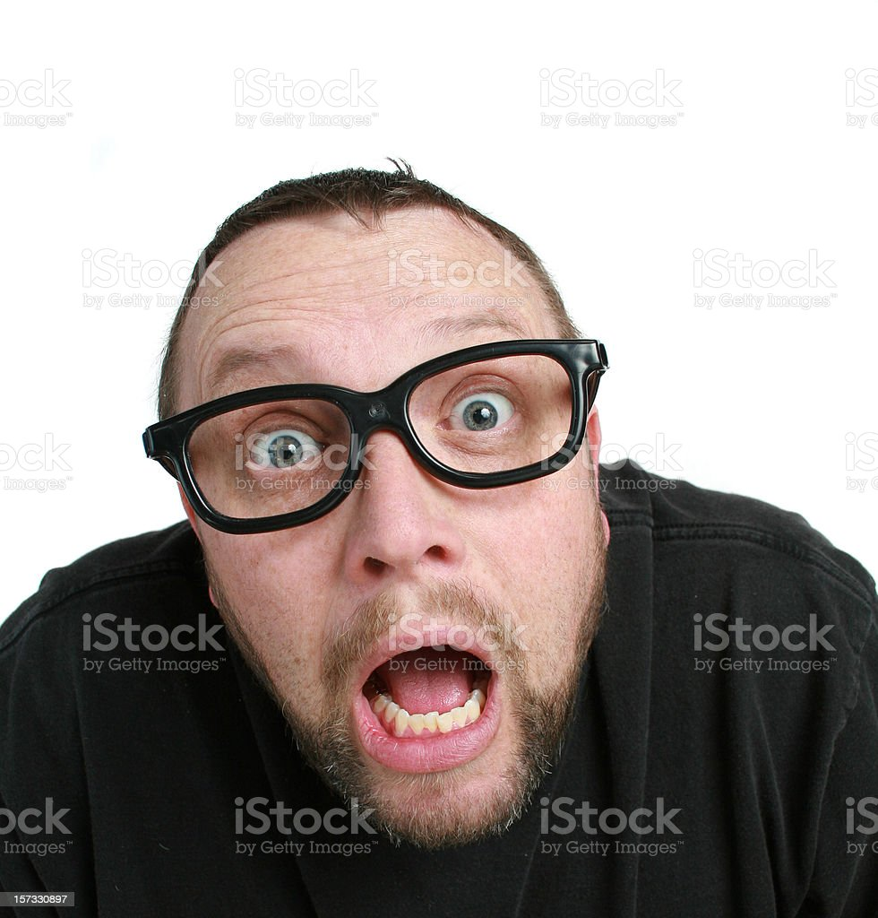 A crazy man in black rimmed glasses making a shocked face royalty-free stock photo