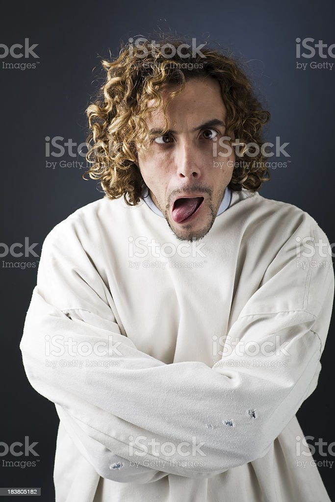 Crazy Man In Straight Jacket With Crossed Eyes stock photo ...