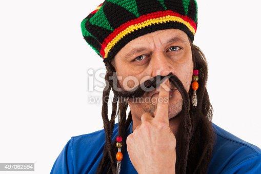 182677415 istock photo Crazy man with dreadlocks wig-isolated 497062594