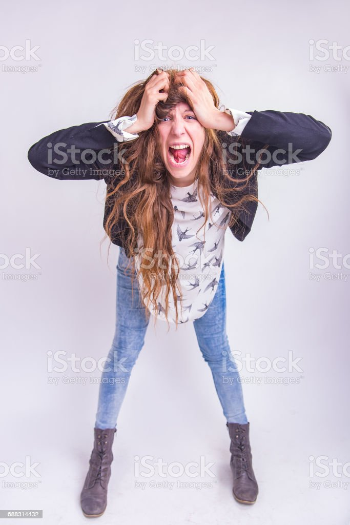 Crazy maniac woman with long hair stock photo