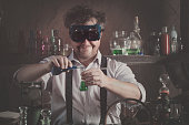 istock crazy medieval scientist working in his laboratory 646836384