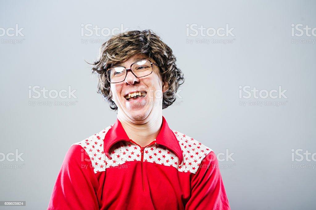 Crazy Nerd Guy Making a Weird Face stock photo