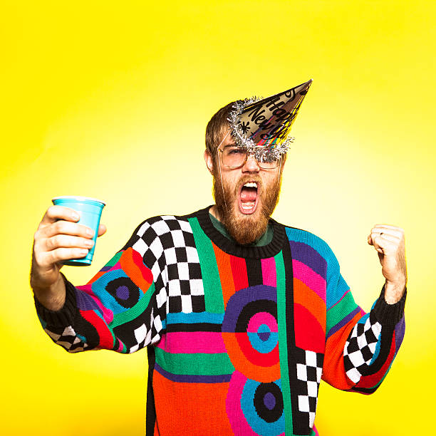 Crazy New Years Party Guy A nerdy party guy toasting his drink, wearing an awful sweater. His New Years party hat is falling off because he's so excited to party! ugliness stock pictures, royalty-free photos & images
