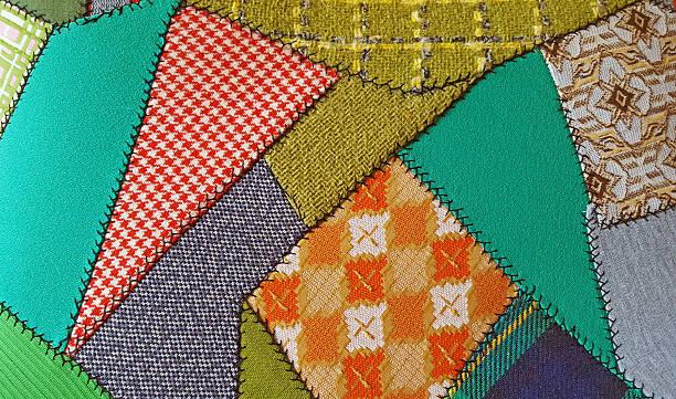 crazy patchwork quilt pattern - patchworkstoffe stock-fotos und bilder