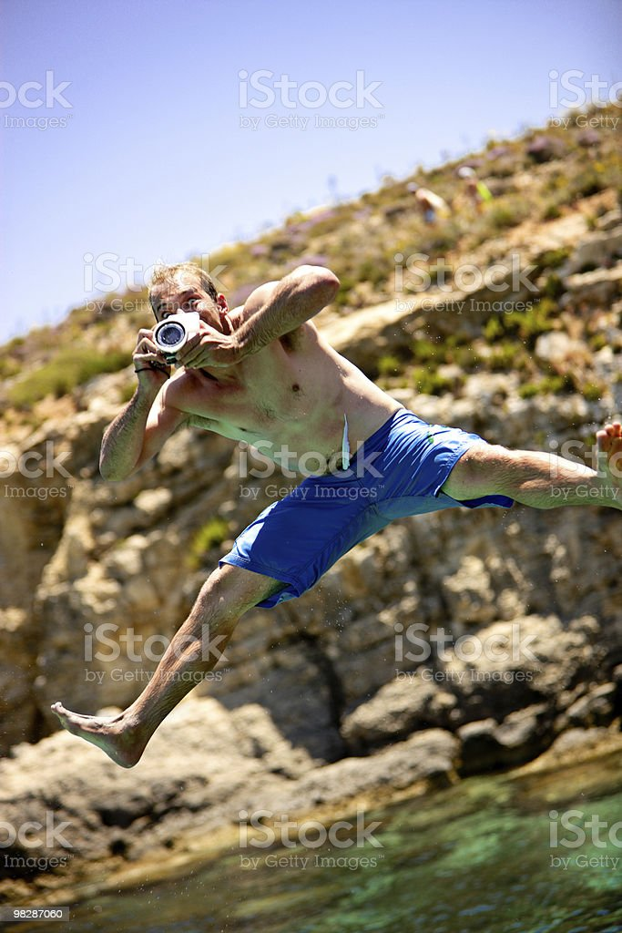 Crazy photographer jumping in water royalty-free stock photo