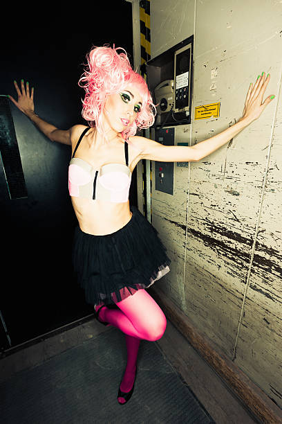 crazy pink punk girl in elevator - punk music stock photos and pictures