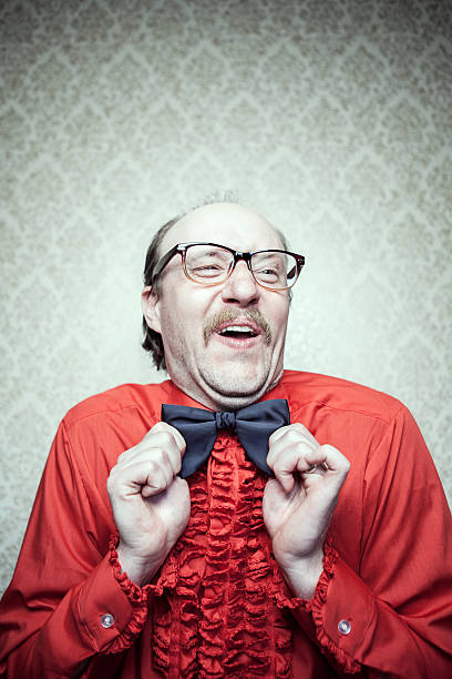 Crazy Proud Butler Man in Red Shirt & Bow Tie stock photo