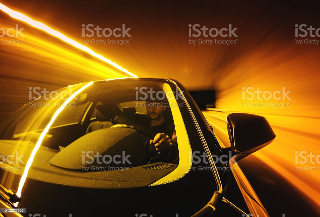 Crazy ride on the night by car stock photo
