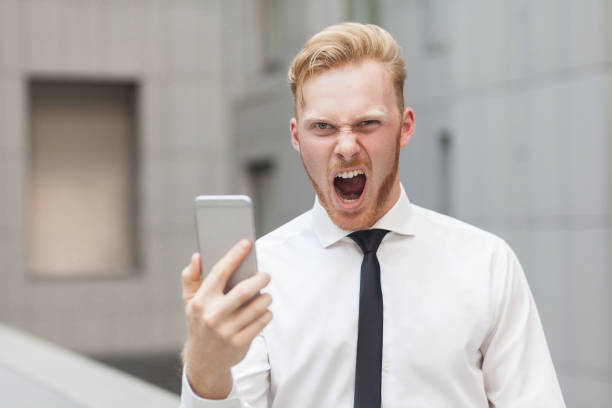 crazy roar and looking at camera. red head businessman. - mobile game stock photos and pictures