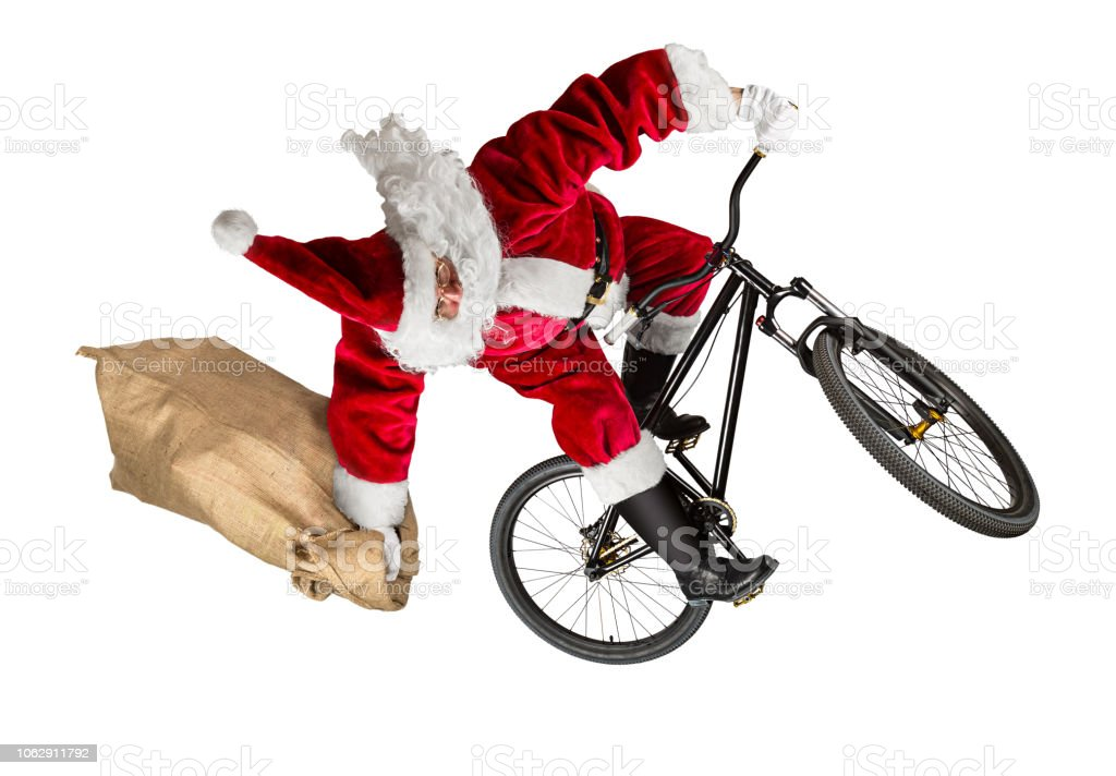 verrückte Weihnachtsmann springen auf Dirt Mountainbike mit Jute Jutesack isoliert – Foto