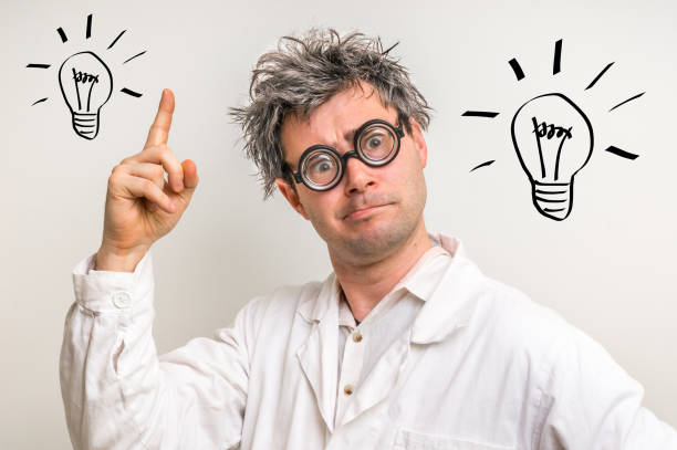 crazy scientist got the great idea with bulb symbol - genius stock photos and pictures