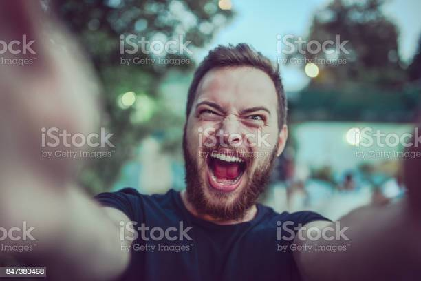 Crazy screaming male taking selfie and making faces outdoors picture id847380468?b=1&k=6&m=847380468&s=612x612&h=togrhmaz617lywxrhmzgndl2kltf3drzdmb11wqbj0i=