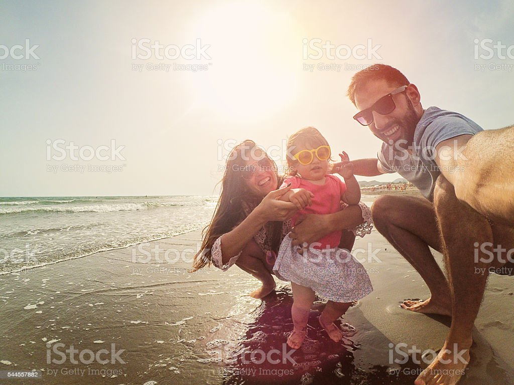 Crazy selfie family with sunglasses on the beach stock photo