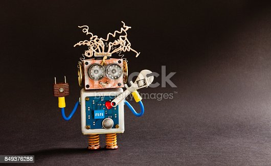 istock Crazy serviceman robot ready with adjustable spanner. Creative design cyborg toy, electric wires hairstyle, big eyeglasses, electronic circuit body, red heart. black background copy space 849376288