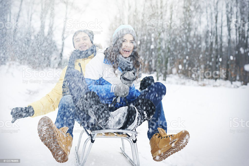 Crazy sledding during the winter stock photo