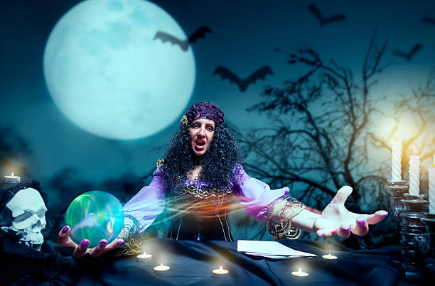 crazy sorceress practising witchcraft - demoniac stock pictures, royalty-free photos & images