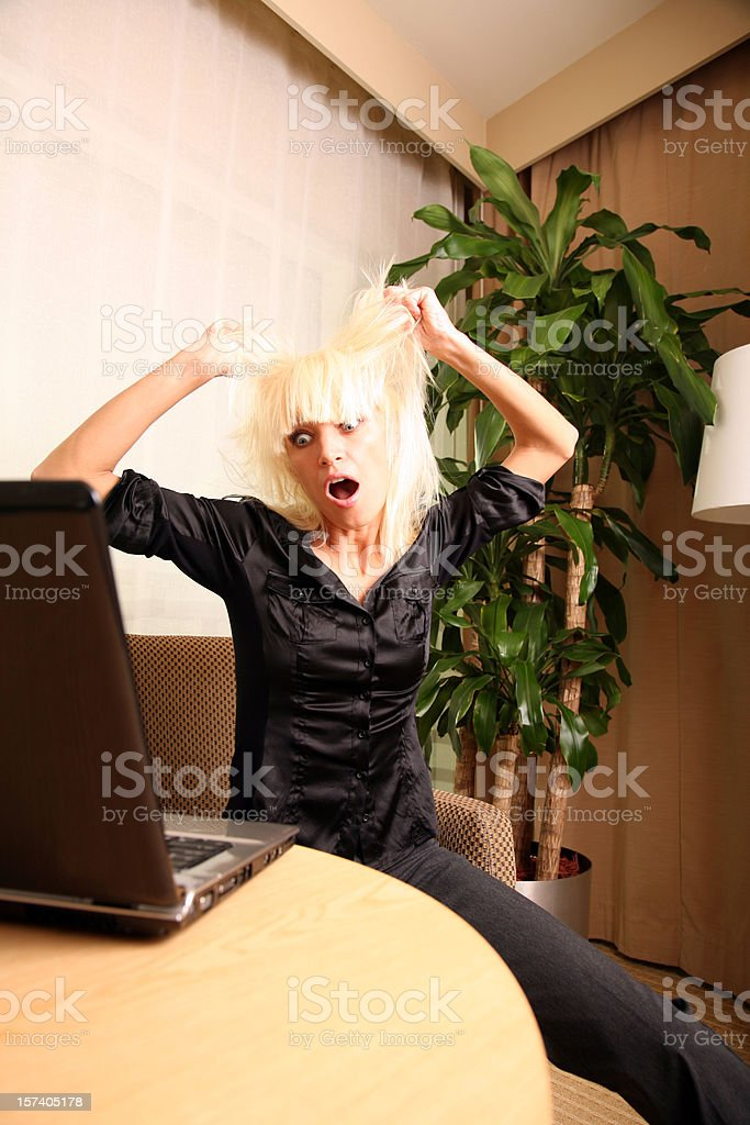 Crazy Stressed Woman looking at Laptop Computer Pulling Hair Out royalty-free stock photo