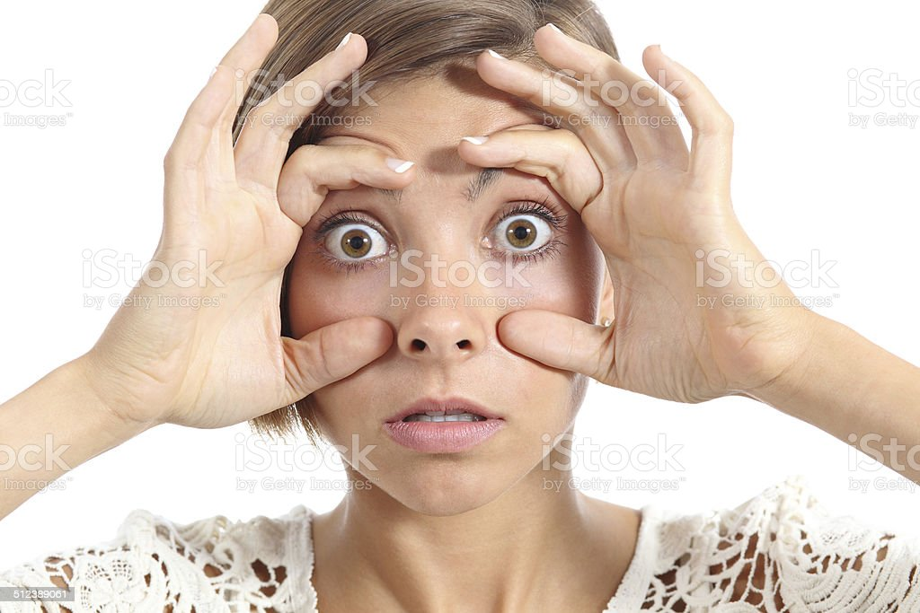 Crazy teenager girl tired trying to open eyes with fingers stock photo