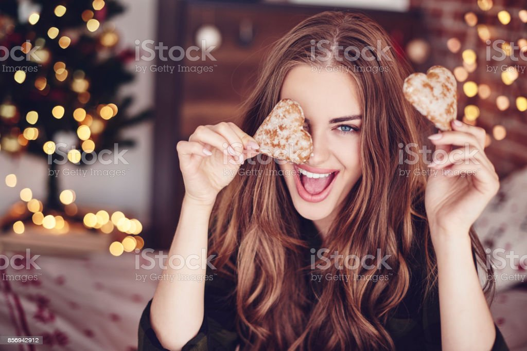 Crazy woman holding cookies in hand stock photo