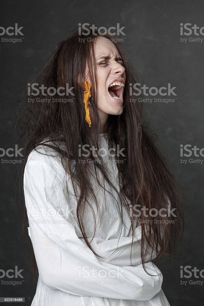 Crazy woman screaming in a straitjacket. Crazy woman screaming in a straitjacket Adult Stock Photo