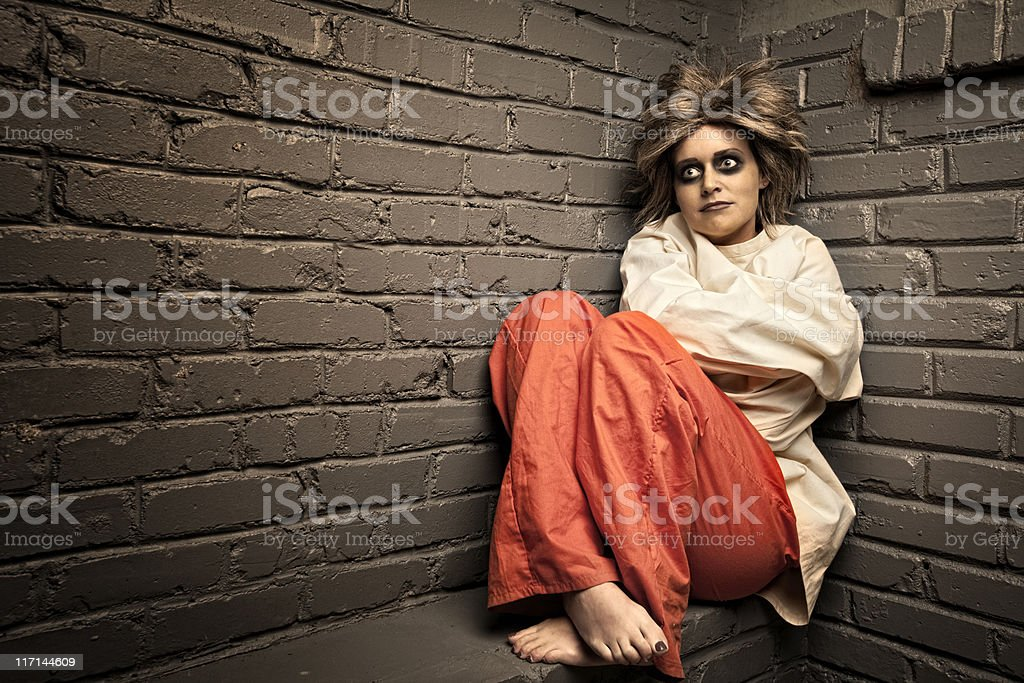 Crazy Woman wearing a straight jacket in an asylum royalty-free stock photo