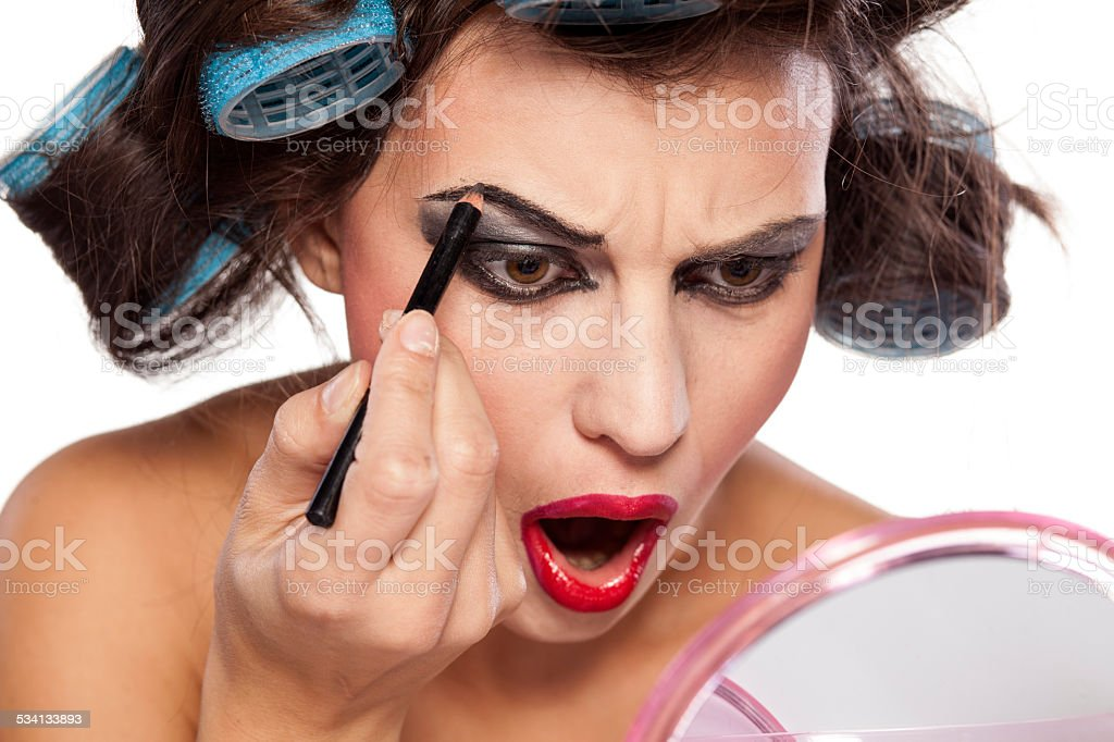 Crazy woman with curlers and bad makeup royalty-free stock photo