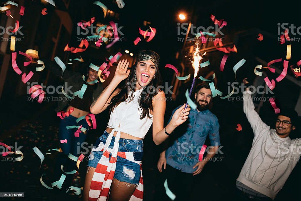 Crazy young friends celebrating new years eve stock photo