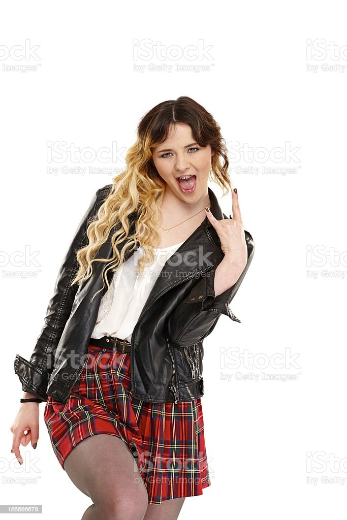 Crazy young girl making rock and roll sign royalty-free stock photo