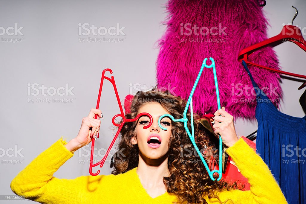 Crazy young girl with clothes stock photo