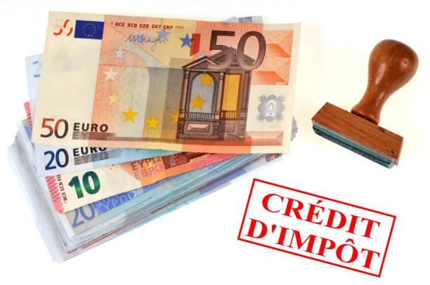 Crédit d'impôt Concept de crédit d'impôt avec des billets de banque et un tampon encreur fifty euro banknote stock pictures, royalty-free photos & images