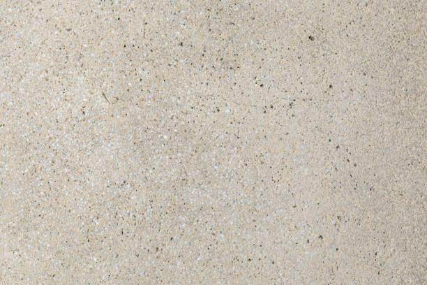 Cream aggregate concrete paving texture stock photo