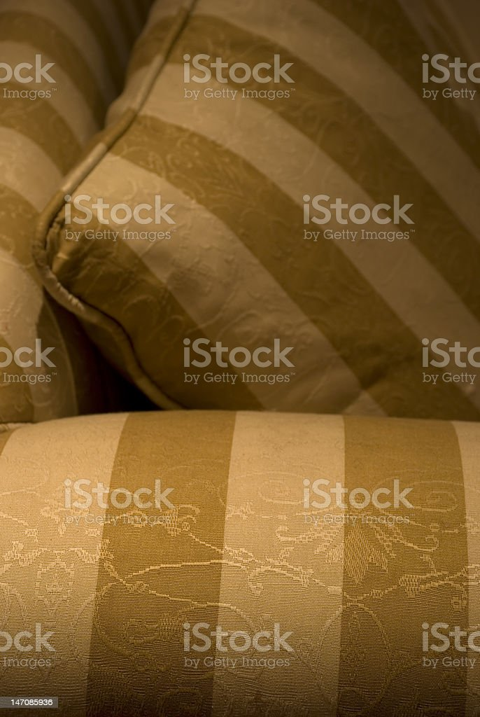 Cream and brown stripe couch with matching pillow stock photo
