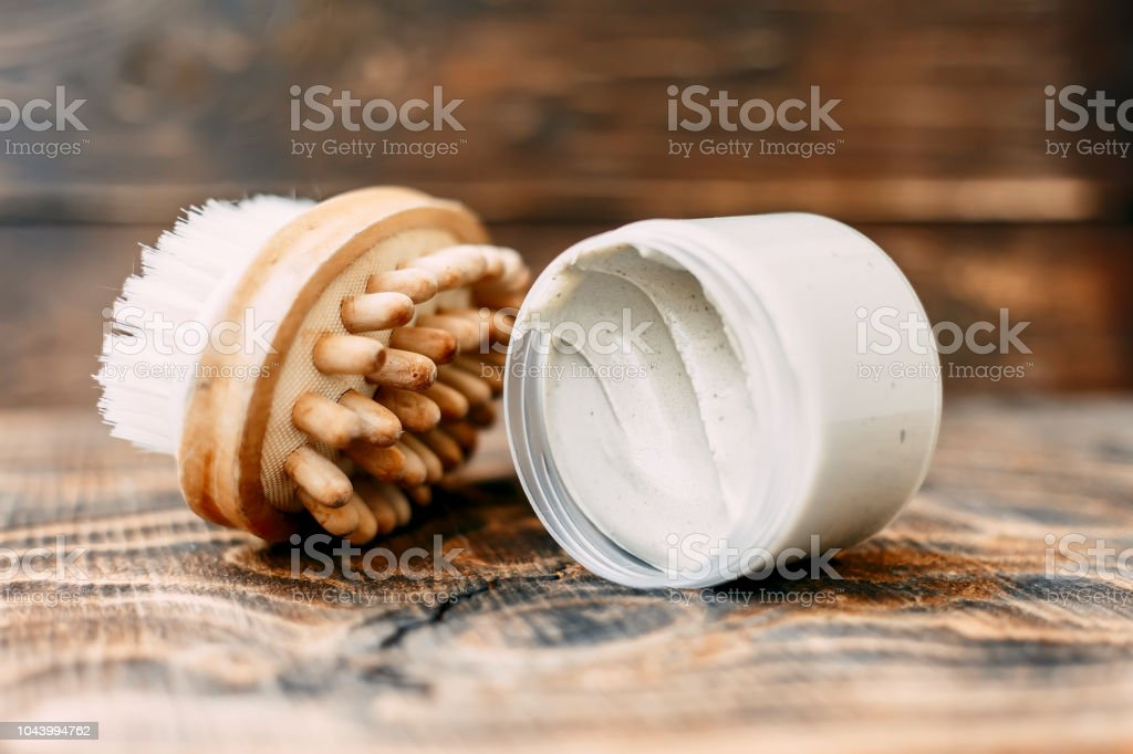cream and brush for body for drying massage, Anticellulite massage - foto stock