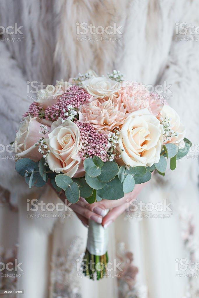 Cream and light pink wedding bouquet stock photo