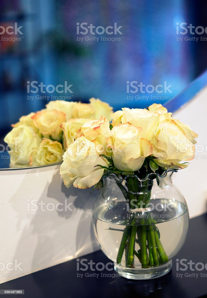cream and pink roses in vase iwth water and reflection royalty-free stock photo