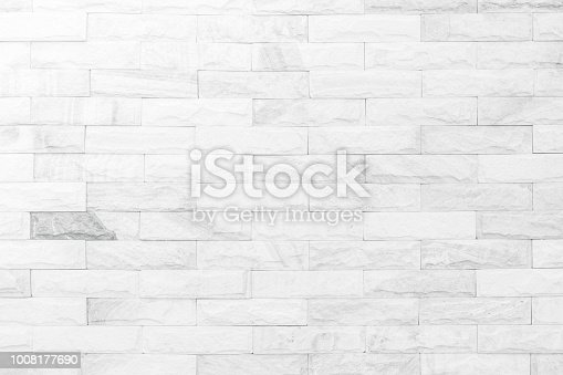 White brick wall texture background. Brickwork or stonework flooring interior rock old pattern clean concrete grid uneven bricks design stack.