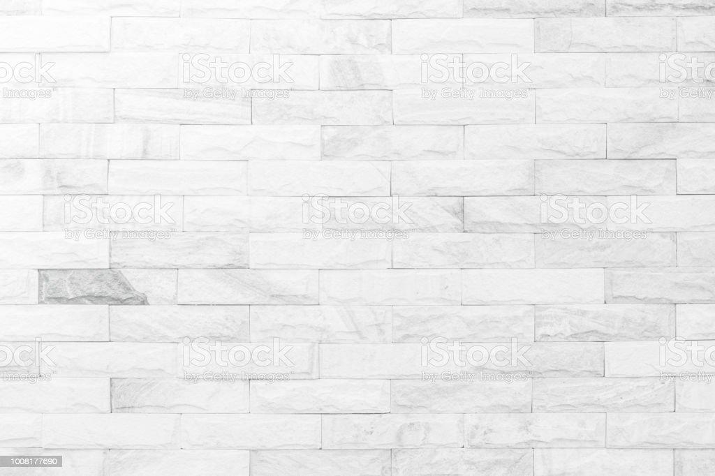 Fundo de textura de parede de tijolo branco e creme. Tijolo ou pedra revestimento antigo padrão de pedra interior limpar grade concreto tijolos irregulares projeto pilha. - foto de acervo