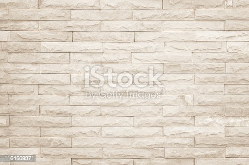 Cream and white wall texture background, brick stone pattern modern decor home and vintage stonework floor interior or design concrete old brickwork stack limestone seamless nature for copy space.
