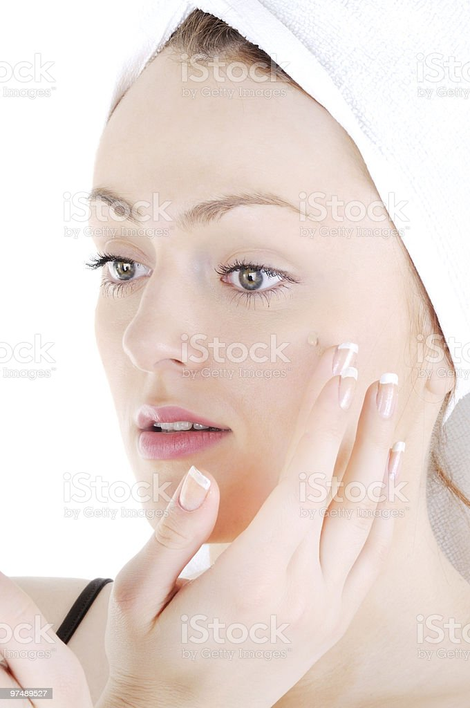 Cream appling on face skin royalty-free stock photo