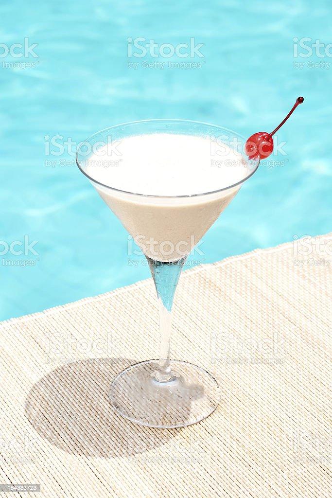 cream brulee martini cocktail near waterpool stock photo