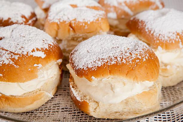 Cream buns Traditional scandinavian cream buns. sweet bun stock pictures, royalty-free photos & images