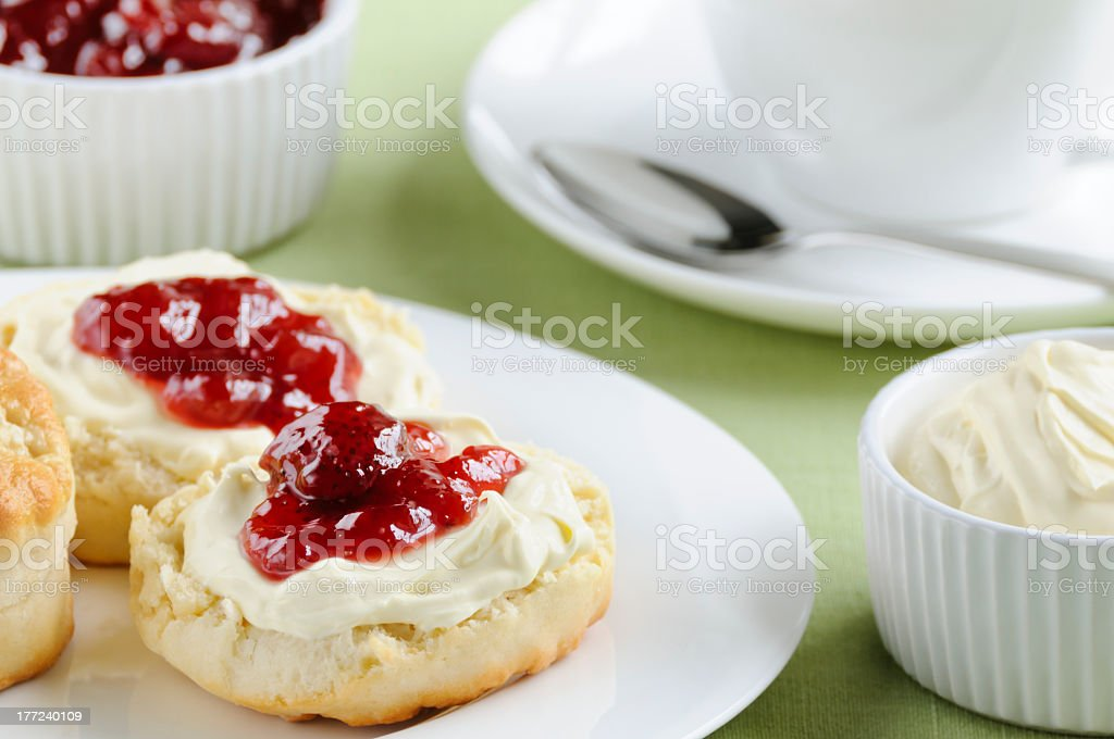 Cream cheese and jelly on an English muffin at tea time stock photo